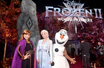 """HOLLYWOOD, CALIFORNIA - NOVEMBER 07: (L-R) Anna, Elsa, and Olaf attend the world premiere of Disney's """"Frozen 2"""" at Hollywood's Dolby Theatre on Thursday, November 7, 2019 in Hollywood, California. (Photo by Alberto E. Rodriguez/Getty Images for Disney)"""
