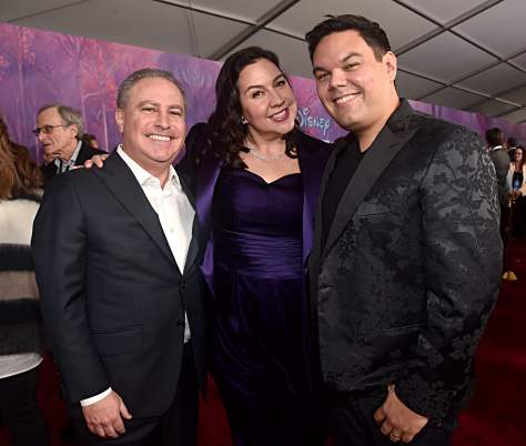 """HOLLYWOOD, CALIFORNIA - NOVEMBER 07: (L-R) Co-Chairman, The Walt Disney Studios Alan Bergman, Songwriters Kristen Anderson-Lopez and Robert Lopez attend the world premiere of Disney's """"Frozen 2"""" at Hollywood's Dolby Theatre on Thursday, November 7, 2019 in Hollywood, California. (Photo by Alberto E. Rodriguez/Getty Images for Disney)"""