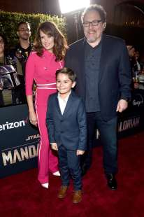 "HOLLYWOOD, CALIFORNIA - NOVEMBER 13: (L-R) Emily Swallow, Aidan Bertola and Executive Producer Jon Favreau arrive at the premiere of Lucasfilm's first-ever, live-action series, ""The Mandalorian,"" at the El Capitan Theatre in Hollywood, Calif. on November 13, 2019. ""The Mandalorian"" streams exclusively on Disney+. (Photo by Alberto E. Rodriguez/Getty Images for Disney)"