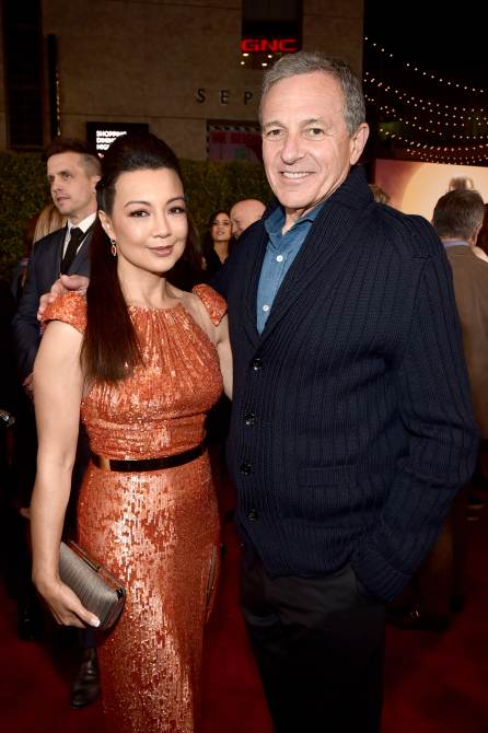 "HOLLYWOOD, CALIFORNIA - NOVEMBER 13: (L-R) Ming-Na Wen and Disney CEO Bob Iger arrive at the premiere of Lucasfilm's first-ever, live-action series, ""The Mandalorian,"" at the El Capitan Theatre in Hollywood, Calif. on November 13, 2019. ""The Mandalorian"" streams exclusively on Disney+. (Photo by Alberto E. Rodriguez/Getty Images for Disney)"