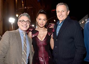"HOLLYWOOD, CALIFORNIA - NOVEMBER 13: (L-R) President, Content and Marketing for Disney+ Ricky Strauss, Sofia Wylie and The Walt Disney Company Chairman and CEO Bob Iger arrive at the premiere of Lucasfilm's first-ever, live-action series, ""The Mandalorian,"" at the El Capitan Theatre in Hollywood, Calif. on November 13, 2019. ""The Mandalorian"" streams exclusively on Disney+. (Photo by Alberto E. Rodriguez/Getty Images for Disney)"