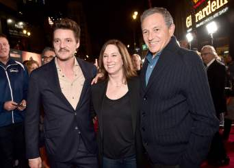 "HOLLYWOOD, CALIFORNIA - NOVEMBER 13: (L-R) Pedro Pascal, Executive Producer Kathleen Kennedy and Disney CEO Bob Iger arrive at the premiere of Lucasfilm's first-ever, live-action series, ""The Mandalorian,"" at the El Capitan Theatre in Hollywood, Calif. on November 13, 2019. ""The Mandalorian"" streams exclusively on Disney+. (Photo by Alberto E. Rodriguez/Getty Images for Disney)"