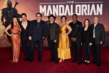 "HOLLYWOOD, CALIFORNIA - NOVEMBER 13: (L-R) Ming-Na Wen, Pedro Pascal, Executive Producer Jon Favreau, Executive Producer/Director Dave Filoni, Gina Carano, Carl Weathers, Executive Producer Kathleen Kennedy and Werner Herzog arrive at the premiere of Lucasfilm's first-ever, live-action series, ""The Mandalorian,"" at the El Capitan Theatre in Hollywood, Calif. on November 13, 2019. ""The Mandalorian"" streams exclusively on Disney+. (Photo by Alberto E. Rodriguez/Getty Images for Disney)"