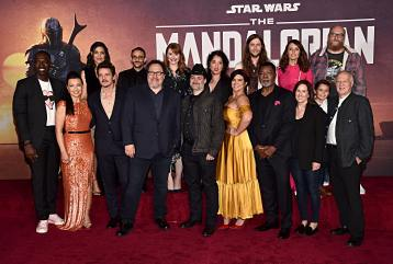 "HOLLYWOOD, CALIFORNIA - NOVEMBER 13: (Back L-R) Rick Famuyiwa, Julia Jones, Omid Abtahi, Director Bryce Dallas Howard, Director Deborah Chow, Composer Ludwig Göransson, Emily Swallow, Brian Posehn, (Front L-R) Ming-Na Wen, Pedro Pascal, Executive Producer Jon Favreau, Executive Producer/Director Dave Filoni, Gina Carano, Carl Weathers, Executive Producer Kathleen Kennedy, Aidan Bertolav and Werner Herzog arrive at the premiere of Lucasfilm's first-ever, live-action series, ""The Mandalorian,"" at the El Capitan Theatre in Hollywood, Calif. on November 13, 2019. ""The Mandalorian"" streams exclusively on Disney+. (Photo by Alberto E. Rodriguez/Getty Images for Disney)"