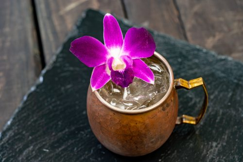 The Vanilla Pear Mule with Fresh, edible orchid is part of the delicious food and drink offerings during Disney Festival of Holidays. Available November 8 - January 6, this item can be be purchased at A Twist on Tradition marketplace in Disney California Adventure. (Disneyland Resort)