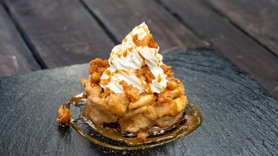 The Apple Fritter Bread Pudding is part of the delicious food offerings during Disney Festival of Holidays. Available November 8 - January 6, this item can be be purchased at Pacific Wharf Cafe in Disney California Adventure. (Disneyland Resort)