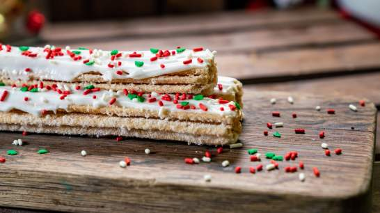 The Sugar Cookie Churro is part of the limited-time holiday treats at The Disneyland Resort. Available November 8 - January 6, the churro is rolled in sugar and topped with white icing and holiday sprinkles. This treat can be be purchased at Cozy Cone Motel in Disney California Adventure Park. (Disneyland Resort)