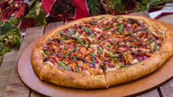 The Holiday Dinner Pizza is part of the limited-time holiday treats at The Disneyland Resort. Available November 8 - January 6, the pizza is topped with roasted turkey, mashed potatoes, turkey gravy, bacon, vegetables and cranberry sauce. This item can be be purchased at Boardwalk Pizza & Pasta in Disney California Adventure Park. (Disneyland Resort)