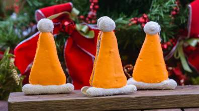 The Santa Cone Hat Macaron is part of the limited-time holiday treats at The Disneyland Resort. Available November 8 - January 6, the macaron has cookies n' cream filling. This treat can be be purchased at Cozy Cone Motel in Disney California Adventure Park. (Disneyland Resort)