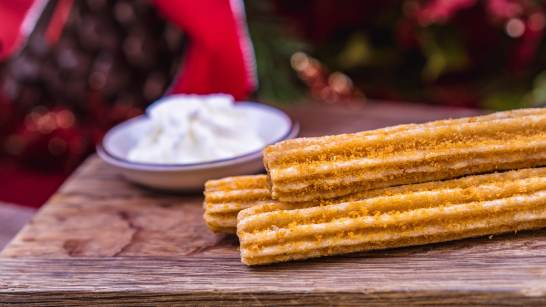 The Gingersnap Churro is part of the limited-time holiday treats at The Disneyland Resort. Available November 8 - January 6, the churro is served with a cream cheese dipping sauce. This treat can be be purchased at Cozy Cone Motel in Disney California Adventure Park. (Disneyland Resort)