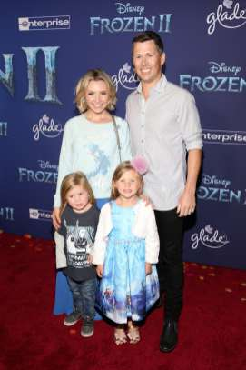 "HOLLYWOOD, CALIFORNIA - NOVEMBER 07: (L-R) Hutton Michael Cameron, Beverley Mitchell, Kenzie Cameron, and Michael Cameron attend the world premiere of Disney's ""Frozen 2"" at Hollywood's Dolby Theatre on Thursday, November 7, 2019 in Hollywood, California. (Photo by Jesse Grant/Getty Images for Disney)"