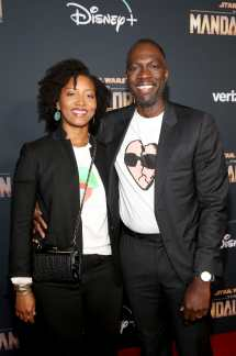 "HOLLYWOOD, CALIFORNIA - NOVEMBER 13: Glenita Mosley and director Rick Famuyiwa arrive at the premiere of Lucasfilm's first-ever, live-action series, ""The Mandalorian,"" at the El Capitan Theatre in Hollywood, Calif. on November 13, 2019. ""The Mandalorian"" streams exclusively on Disney+. (Photo by Jesse Grant/Getty Images for Disney)"