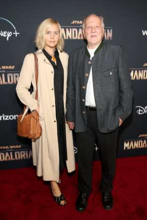 "HOLLYWOOD, CALIFORNIA - NOVEMBER 13: (L-R) Lena Herzog and Werner Herzog arrive at the premiere of Lucasfilm's first-ever, live-action series, ""The Mandalorian,"" at the El Capitan Theatre in Hollywood, Calif. on November 13, 2019. ""The Mandalorian"" streams exclusively on Disney+. (Photo by Jesse Grant/Getty Images for Disney)"
