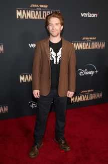 "HOLLYWOOD, CALIFORNIA - NOVEMBER 13: Seth Green arrives at the premiere of Lucasfilm's first-ever, live-action series, ""The Mandalorian,"" at the El Capitan Theatre in Hollywood, Calif. on November 13, 2019. ""The Mandalorian"" streams exclusively on Disney+. (Photo by Jesse Grant/Getty Images for Disney)"