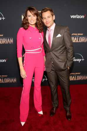 "HOLLYWOOD, CALIFORNIA - NOVEMBER 13: (L-R) Emily Swallow and Chad Kimball arrive at the premiere of Lucasfilm's first-ever, live-action series, ""The Mandalorian,"" at the El Capitan Theatre in Hollywood, Calif. on November 13, 2019. ""The Mandalorian"" streams exclusively on Disney+. (Photo by Jesse Grant/Getty Images for Disney)"