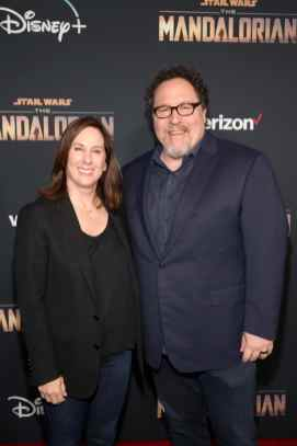 "HOLLYWOOD, CALIFORNIA - NOVEMBER 13: (L-R) Executive Producer Kathleen Kennedy and Executive Producer Jon Favreau arrive at the premiere of Lucasfilm's first-ever, live-action series, ""The Mandalorian,"" at the El Capitan Theatre in Hollywood, Calif. on November 13, 2019. ""The Mandalorian"" streams exclusively on Disney+. (Photo by Jesse Grant/Getty Images for Disney)"