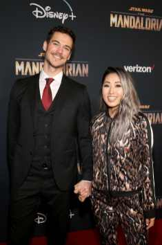 "HOLLYWOOD, CALIFORNIA - NOVEMBER 13: Mari Takahashi (L) and guest arrive at the premiere of Lucasfilm's first-ever, live-action series, ""The Mandalorian,"" at the El Capitan Theatre in Hollywood, Calif. on November 13, 2019. ""The Mandalorian"" streams exclusively on Disney+. (Photo by Jesse Grant/Getty Images for Disney)"
