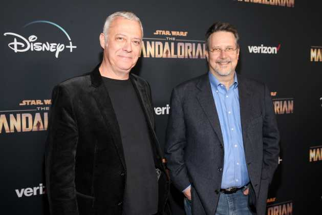 "HOLLYWOOD, CALIFORNIA - NOVEMBER 13: Animation supervisor Hal Hickel and ILM VFX supervisor John Knoll arrive at the premiere of Lucasfilm's first-ever, live-action series, ""The Mandalorian,"" at the El Capitan Theatre in Hollywood, Calif. on November 13, 2019. ""The Mandalorian"" streams exclusively on Disney+. (Photo by Jesse Grant/Getty Images for Disney)"
