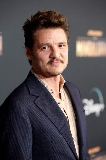"HOLLYWOOD, CALIFORNIA - NOVEMBER 13: Pedro Pascal arrives at the premiere of Lucasfilm's first-ever, live-action series, ""The Mandalorian,"" at the El Capitan Theatre in Hollywood, Calif. on November 13, 2019. ""The Mandalorian"" streams exclusively on Disney+. (Photo by Jesse Grant/Getty Images for Disney)"