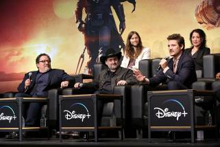 "HOLLYWOOD, CALIFORNIA - NOVEMBER 13: (L-R) Executive Producer Jon Favreau, Executive Producer/Director Dave Filoni, Composer Ludwig Göransson, Pedro Pascal and Director Deborah Chow speak onstage at the premiere of Lucasfilm's first-ever, live-action series, ""The Mandalorian,"" at the El Capitan Theatre in Hollywood, Calif. on November 13, 2019. ""The Mandalorian"" streams exclusively on Disney+. (Photo by Jesse Grant/Getty Images for Disney)"