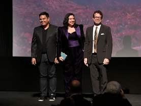 """HOLLYWOOD, CALIFORNIA - NOVEMBER 07: (L-R) Songwriters Robert Lopez, Kristen Anderson-Lopez, and Composer Christophe Beck attend the world premiere of Disney's """"Frozen 2"""" at Hollywood's Dolby Theatre on Thursday, November 7, 2019 in Hollywood, California. (Photo by Jesse Grant/Getty Images for Disney)"""