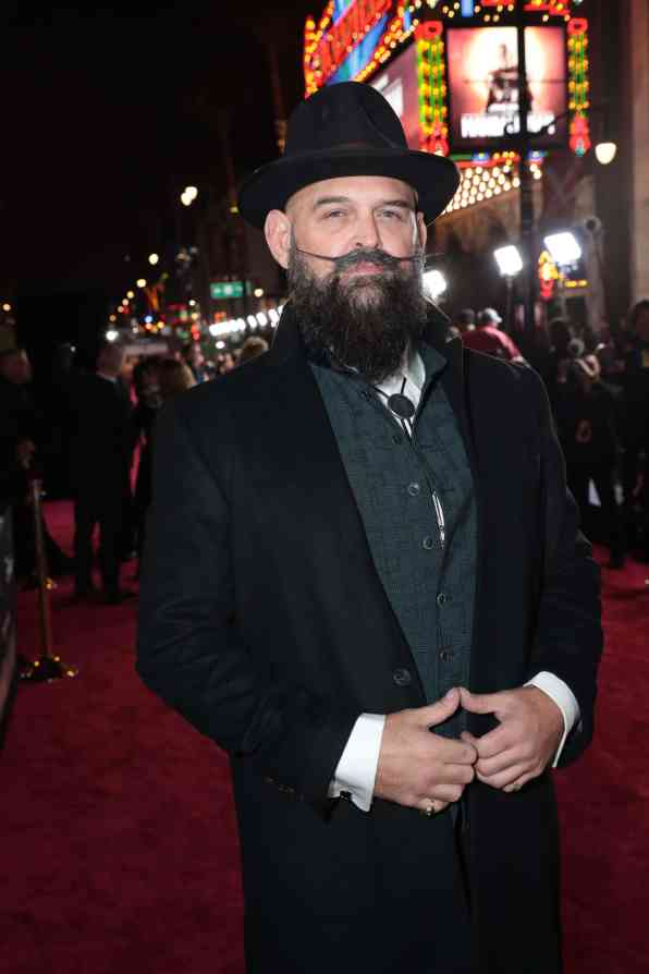 "Tait Fletcher arrives at the premiere of Lucasfilm's first-ever, live-action series, ""The Mandalorian"", at the El Capitan Theatre in Hollywood, CA on November 13, 2019. ""The Mandalorian"" streams exclusively on Disney+.(photo: Alex J. Berliner/ABImages)"