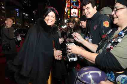 "Gina Carano signs autographs for fans at the premiere of Lucasfilm's first-ever, live-action series, ""The Mandalorian"", at the El Capitan Theatre in Hollywood, CA on November 13, 2019. ""The Mandalorian"" streams exclusively on Disney+.(photo: Alex J. Berliner/ABImages)"