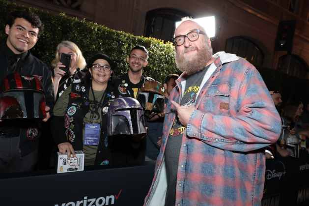 "Brian Posehn poses with fans at the premiere of Lucasfilm's first-ever, live-action series, ""The Mandalorian"", at the El Capitan Theatre in Hollywood, CA on November 13, 2019. ""The Mandalorian"" streams exclusively on Disney+.(photo: Alex J. Berliner/ABImages)"