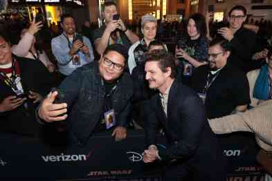 "Pedro Pascal takes selfies with fans at the premiere of Lucasfilm's first-ever, live-action series, ""The Mandalorian"", at the El Capitan Theatre in Hollywood, CA on November 13, 2019. ""The Mandalorian"" streams exclusively on Disney+.(photo: Alex J. Berliner/ABImages)"