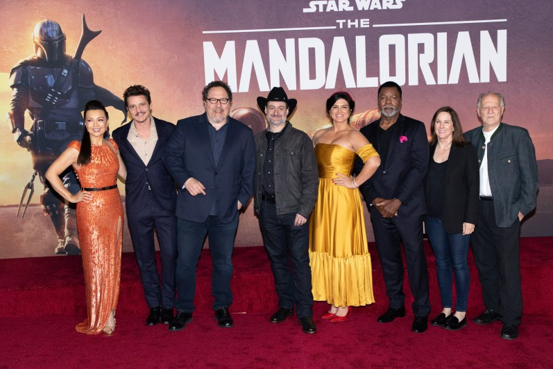 "Ming-Na Wen, Pedro Pascal, Executive Prodcuer Jon Favreau, Executive Producer Dave Filoni, Gina Carano, Carl Weathers, Kathleen Kennedy and Werner Herzof arrive at the premiere of Lucasfilm's first-ever, live-action series, ""The Mandalorian"", at the El Capitan Theatre in Hollywood, CA on November 13, 2019. ""The Mandalorian"" streams exclusively on Disney+.(photo: Alex J. Berliner/ABImages)"
