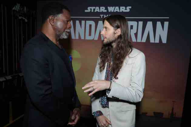 "Carl Weathers and Composer Ludwig Goransson chat backstage at the premiere of Lucasfilm's first-ever, live-action series, ""The Mandalorian"", at the El Capitan Theatre in Hollywood, CA on November 13, 2019. ""The Mandalorian"" streams exclusively on Disney+.(photo: Alex J. Berliner/ABImages)"