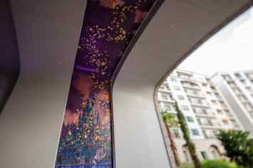 "Part of the unique artwork at this resort are the two mosaic murals in the arched tunnel which lead to the nearby Disney Skyliner station. One mural shows London at night, with Peter Pan, Wendy, Michael and John flying off to Neverland and the other shows Rapunzel's floating lantern scene from ""Tangled."" (Steven Diaz, photographer)"