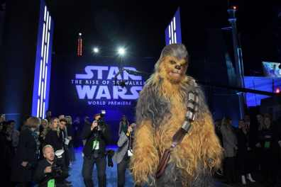 "HOLLYWOOD, CALIFORNIA - DECEMBER 16: Chewbacca arrives for the World Premiere of ""Star Wars: The Rise of Skywalker"", the highly anticipated conclusion of the Skywalker saga on December 16, 2019 in Hollywood, California. (Photo by Charley Gallay/Getty Images for Disney)"