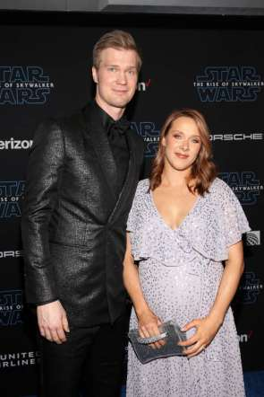 "HOLLYWOOD, CALIFORNIA - DECEMBER 16: (L-R) Joonas Suotamo and Milla Pohjasvaara arrive for the World Premiere of ""Star Wars: The Rise of Skywalker"", the highly anticipated conclusion of the Skywalker saga on December 16, 2019 in Hollywood, California. (Photo by Jesse Grant/Getty Images for Disney)"