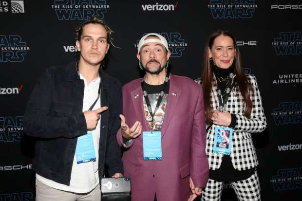 "HOLLYWOOD, CALIFORNIA - DECEMBER 16: (L-R) Jason Mewes, Kevin Smith, and Jennifer Schwalbach Smith arrive for the World Premiere of ""Star Wars: The Rise of Skywalker"", the highly anticipated conclusion of the Skywalker saga on December 16, 2019 in Hollywood, California. (Photo by Jesse Grant/Getty Images for Disney)"