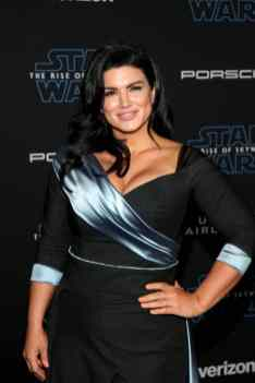 "HOLLYWOOD, CALIFORNIA - DECEMBER 16: Gina Carano arrives for the World Premiere of ""Star Wars: The Rise of Skywalker"", the highly anticipated conclusion of the Skywalker saga on December 16, 2019 in Hollywood, California. (Photo by Jesse Grant/Getty Images for Disney)"
