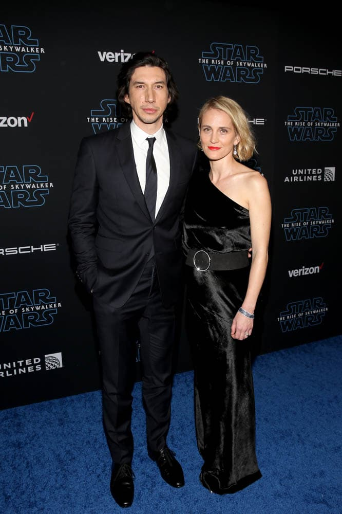 "HOLLYWOOD, CALIFORNIA - DECEMBER 16: (L-R) Adam Driver and Joanne Tucker arrive for the World Premiere of ""Star Wars: The Rise of Skywalker"", the highly anticipated conclusion of the Skywalker saga on December 16, 2019 in Hollywood, California. (Photo by Jesse Grant/Getty Images for Disney)"