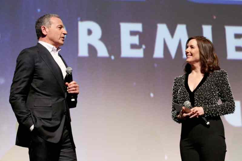 "HOLLYWOOD, CALIFORNIA - DECEMBER 16: (L-R) The Walt Disney Company Chairman and CEO Bob Iger and Producer and President of Lucasfilm Kathleen Kennedy speak onstage during the World Premiere of ""Star Wars: The Rise of Skywalker"", the highly anticipated conclusion of the Skywalker saga on December 16, 2019 in Hollywood, California. (Photo by Jesse Grant/Getty Images for Disney)"