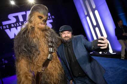 Chewbacca and Bobby Moynihan arrive for the World Premiere of Star Wars: The Rise of Skywalker, the highly anticipated conclusion of the Skywalker saga, in Hollywood, CA, on December 16, 2019..(photo: Alex J. Berliner/ABImages)