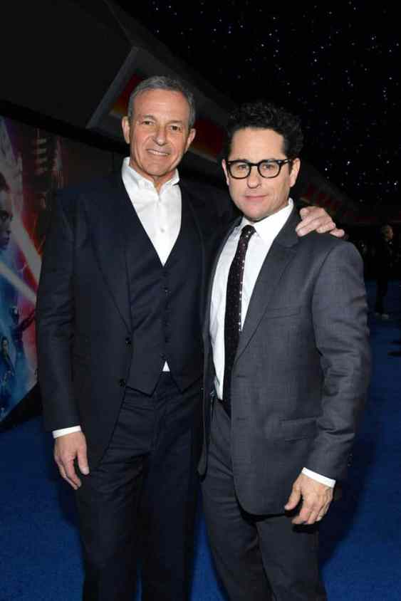 "HOLLYWOOD, CALIFORNIA - DECEMBER 16: (L-R) The Walt Disney Company Chairman and CEO Bob Iger and Director, Writer and Producer J.J. Abrams arrive for the World Premiere of ""Star Wars: The Rise of Skywalker"", the highly anticipated conclusion of the Skywalker saga on December 16, 2019 in Hollywood, California. (Photo by Amy Sussman/Getty Images for Disney)"