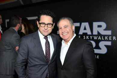 "HOLLYWOOD, CALIFORNIA - DECEMBER 16: Director/writer/producer J.J. Abrams and Co-Chairman, The Walt Disney Studios Alan Bergman arrive for the World Premiere of ""Star Wars: The Rise of Skywalker"", the highly anticipated conclusion of the Skywalker saga on December 16, 2019 in Hollywood, California. (Photo by Amy Sussman/Getty Images for Disney)"