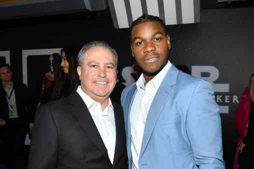 "HOLLYWOOD, CALIFORNIA - DECEMBER 16: Co-Chairman, The Walt Disney Studios Alan Bergman and John Boyega arrive for the World Premiere of ""Star Wars: The Rise of Skywalker"", the highly anticipated conclusion of the Skywalker saga on December 16, 2019 in Hollywood, California. (Photo by Amy Sussman/Getty Images for Disney)"