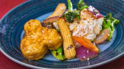 This orange tempeh dish can be found at Disney California Adventure Park as Disneyland Resort celebrates the Year of the Mouse this Lunar New Year, Jan. 17 through Feb. 9, 2020. During the 24 days of this multicultural celebration, guests will enjoy exciting live entertainment and musical performances, plus inspired food and beverage items across festival marketplaces. (David/Nguyen Disneyland Resort)