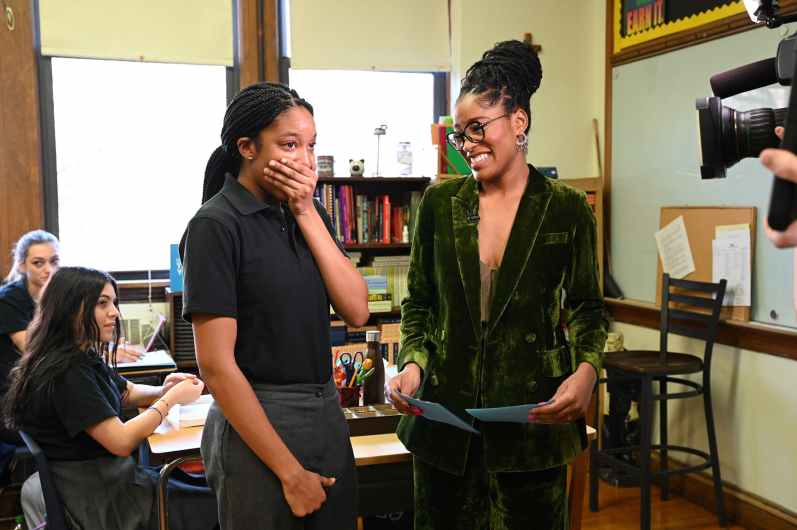 """Keke Palmer (right) of ABC's """"Good Morning America"""" visits Myah Mitchell (left) at her school in Queen, N.Y., Jan. 16, 2020, to surprise her live on air with the news Mitchell will be part of the 2020 class for Disney Dreamers Academy at Walt Disney World Resort in Lake Buena Vista, Fla. (Walt Disney Television/Lorenzo Bevilaqua)"""