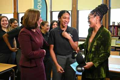 """Keke Palmer (right) of ABC's """"Good Morning America"""" visits Myah Mitchell (center) at her school in Queen, N.Y., Jan. 16, 2020, to surprise her live on air with the news Mitchell will be part of the 2020 class for Disney Dreamers Academy at Walt Disney World Resort in Lake Buena Vista, Fla. (Walt Disney Television/Lorenzo Bevilaqua)"""