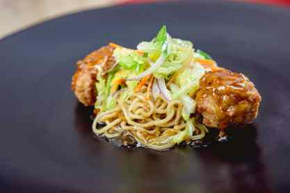 The lo mein noodles dish with chicken meatball, cabbage salad and apple ginger slaw can be found at Disney California Adventure Park as Disneyland Resort celebrates the Year of the Mouse this Lunar New Year, Jan. 17 through Feb. 9, 2020. During the 24 days of this multicultural celebration, guests will enjoy exciting live entertainment and musical performances, plus inspired food and beverage items across festival marketplaces. (David/Nguyen Disneyland Resort)