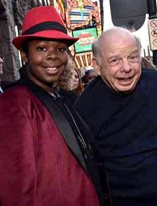 """HOLLYWOOD, CALIFORNIA - JANUARY 30: Kei and Wallace Shawn attend the premiere of Disney's """"Timmy Failure: Mistakes Were Made"""" at Hollywood's El Capitan Theater on January 30, 2020. """"Timmy Failure: Mistakes Were Made"""" premieres on February 7, 2020, streaming only on Disney+. (Photo by Alberto E. Rodriguez/Getty Images for Disney)"""