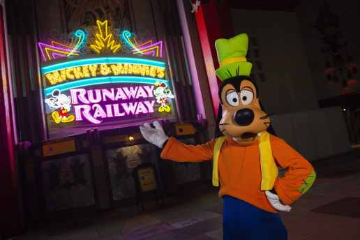 Goofy plays a role in Mickey & Minnie's Runaway Railway, the family-friendly new attraction opening March 4, 2020, inside Disney's Hollywood Studios at Walt Disney World Resort in Lake Buena Vista, Fla. The attraction marquee features blinking bulbs and animated neon depictions of Mickey Mouse and Minnie Mouse, welcoming guests into the lobby of the Chinese Theatre, where they will cross over into the whimsical cartoon world. (Abigail Nillson, photographer)