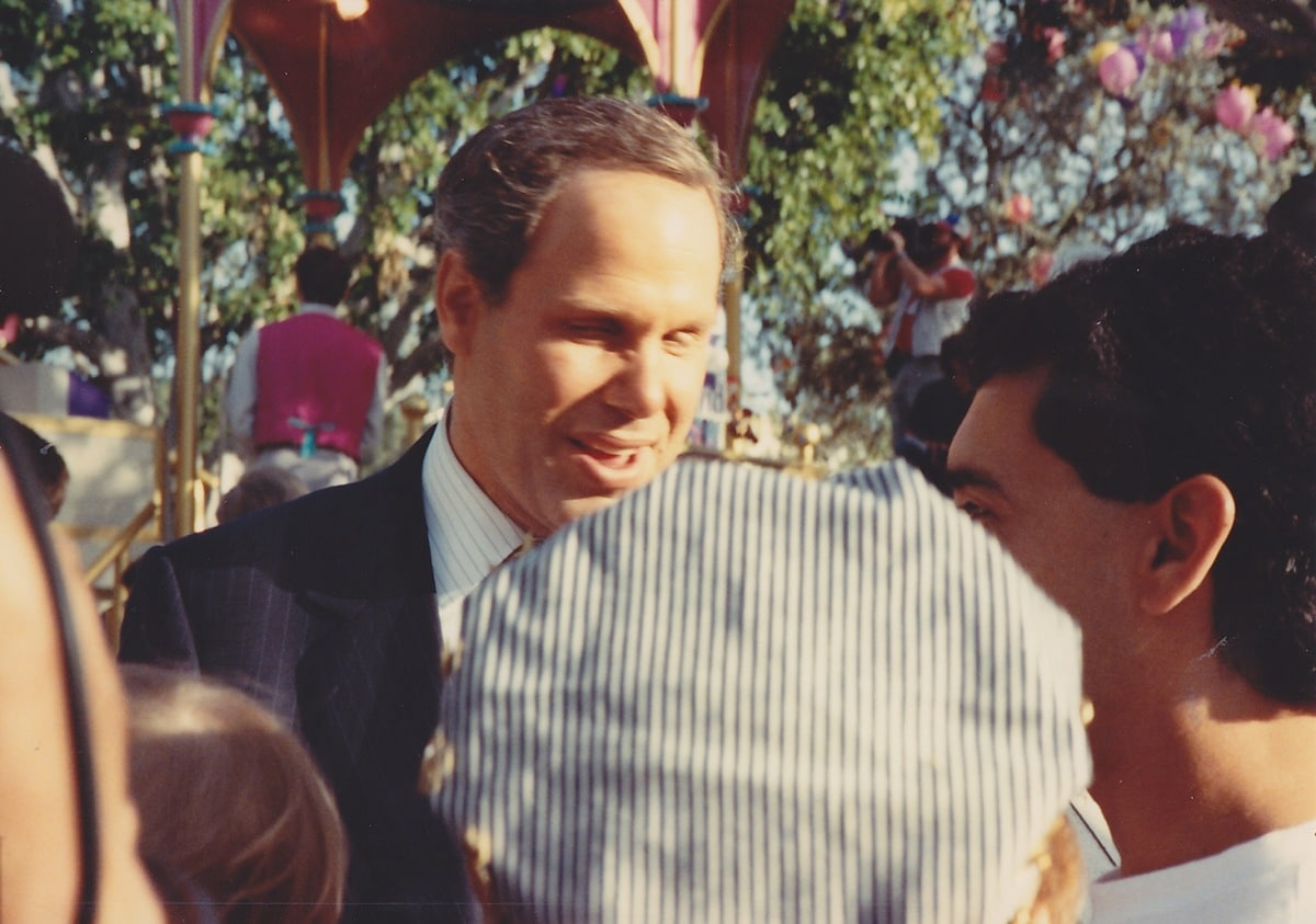 A not entirely delighted Michael Eisner finds himself in intimate conversation with park fans.