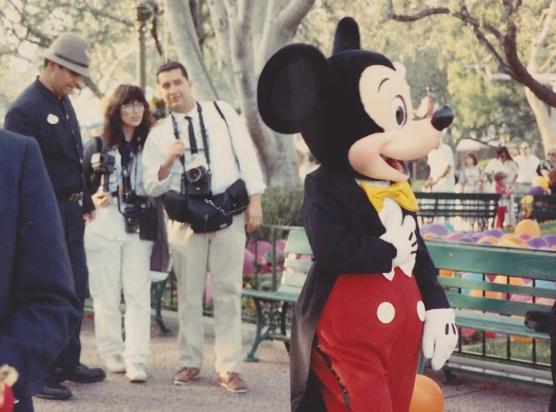 Despite the paparazzi and thimble hatted security hosts, Mickey still has a smile for everyone.